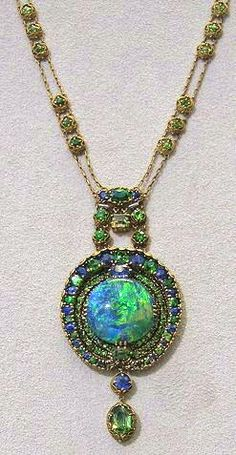 Tiffany & Co black opal, demantoid garnet and sapphire necklace, with a square cut green sapphire drop and a gold filigree frame, c1910 (Christie's)