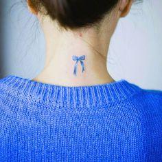 Blue ribbon tattoo by Nando