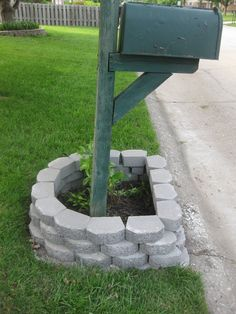 Mailbox Makeover: stacked pavers around mailbox- so simple and clean looking and it'd be super easy to put flowers in to add color