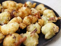 Deep fry cauliflower- crunchy snack, easy meat-substitute, later stir fry them with basil and bell pepper