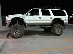 #Ford Excursion on 44's w/ modified Cut-Out Fender Flares