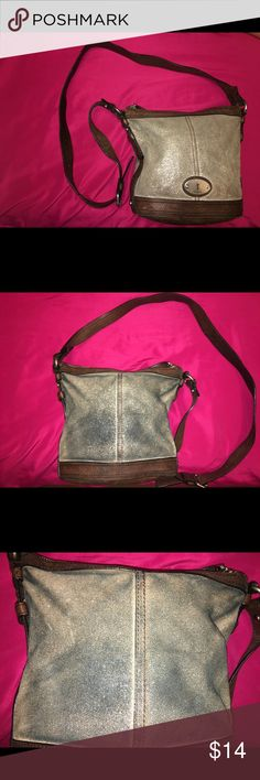 Fossil brown and silver glitter crossbody. Fossil brown and silver glitter crossbody. Measurements are: width is 11 inches, height is 10 inches, side is 5 inches and strap is 48 inches. It's a little dirty inside, blue jean staining on the back and there is scratching. Please see pictures. Price is firm. Fossil Bags Crossbody Bags