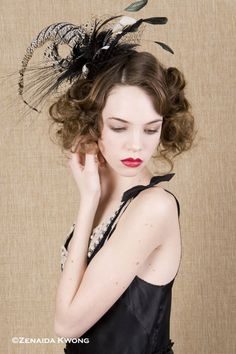 Black and white feathered comb with nose veil     $94.00