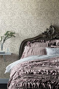 Inspired by rococo design, the Menara Bed shows off shapely curves and foliate details in handcarved acacia wood.
