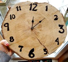 Here is a great DIY clock, especially if you love the outdoors. Make a clock from a slice of tree trunk.