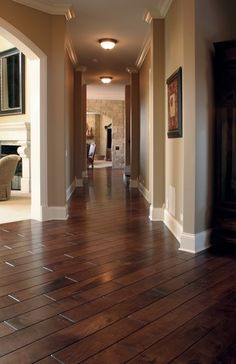 Black Walnut hardwood floor, smooth face, hand beveled,stained in custom color, site finished with Synteco 35 (Satin) Baseboards and crown molding Walnut Hardwood Flooring, Dark Hardwood, Wood Flooring Cost, Walnut Wood, Hickory Flooring, Walnut Stain, Engineered Hardwood, Wood Paneling, Home Interior