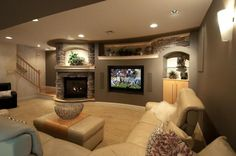 Contemporary Living Room with Sunken living room, West elm mongolian lamb pillow cover, Wall sconce, Carpet, stone fireplace