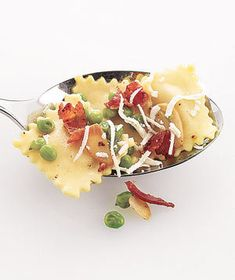 Ravioli With Peas and Crispy Bacon   Unexpected accompaniments take your favorite stuffed pasta to new heights.