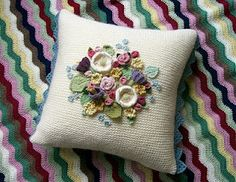 Posy Cushion..... knit pillow with crochet flowers