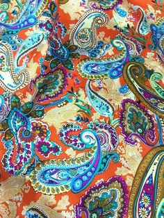 """Soft & Smooth Very Nice Faux Silk Satin Print Fabric Material!Color: OrangeWidth: 48"""" WideLength: Sold by the yardPattern: Paisley & FloralGreat for making dresses, tops, skirts, scarves, wild rags, craft and more...Fabric being sold by the yard: 1 quantity is 1 yard.Buying more than 1 yard, fabric will be cut continuously.Shipping:      ~ Flat Rate Shipping      ~ Free Shipping when order $35 (US address only).     ~ Shipping estimates time: 12-14 business days.Thank you very much. Red And Blue, Orange Red, Blue Brown, Silk Satin Fabric, Scarf Dress, Orange Background, Western Cowboy, Neck Scarves, Paisley Print"""