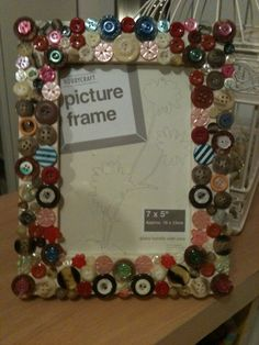 button decorated picture frame