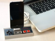This iPhone dock made out of an NES controller.   The 15 Best Uses Of Recycled Video Game Hardware
