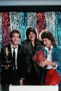 """Photo: Huey Lewis, Steve Perry, and Jack Blades pose for a photo at the 1985 """"Bammies"""", or the Bay Area Music Awards, hosted every year since 1977 by BAM, a San Francisco music magazine. Lewis won Bay Area Musician of the Year, Perry won Outstanding Album and Outstanding Male Vocalist, and Blades received a Bammie for Outstanding Bassist. March 23, 1985 San Francisco, California, USA"""