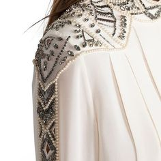 Pleated blouse with beaded sleeve detail; sewing idea; embroidery; embellished fashion details // Haute Hippie #model#fashiondesign#inspiration#artist#motivation#lifestyle#fashionblogger#designer#lifestyle#illustration#luxury#instamood#fashiontv#dresses#highfashion#houtecouture#fashiondaily#houtecouturedress#art#skill#creation#fashion#fashionable#manipulatio#details#fabric#professional#sewing#structure#texture#instagram