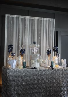 This is visually stunning but not accessible. All the candy will still be in the jars at the end of the evening.