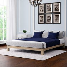 Create a modern look in any bedroom in your home with this Aura deluxe platform bed from Motif Design. The durable metal frame is designed to last, and it features a steel center support to prevent yo