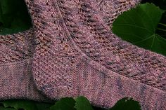"""Lace pattern socks, knit from the top down. The pattern includes both charts and written instructions. The design is based on the """"Fern Lace"""" stitch pattern."""