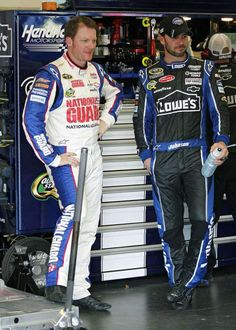Dale Earnhardt Jr. (left) and Jimmie Johnson take a break in the garage Thursday during practice for the Coke Zero 400 at Daytona International Speedway.