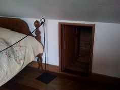 The entrance to the garret could be easily hidden by pushing a bed in front of it. The space was extremely tiny.....