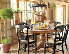Sumner extending pedestal dining table & Napoleon® Rush chair - I love the contrast of the table and chairs.