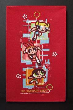 Original PowerPuff Girls T-shirt repurposed into an original piece of wall art! Help Blossom, Bubbles and Buttercup save Townsville!!!. Made from a vintage PowerPuff Girls T-shirt stretched over wooden canvas stretchers and coated in a non-toxic preservative.