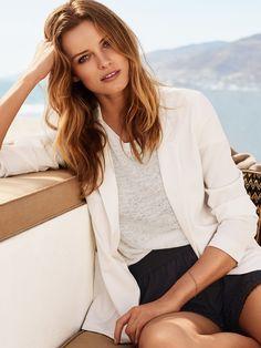 Edita models a blazer, top and shorts