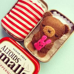 I love the idea of re-using tins- there are so many cute ones out there but I just don't know what to do with-toyinatinbear