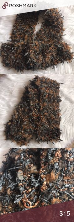 """Woman's Fun Winter Scarf Woman's heavy fun winter scarf.  Knit scarf with tons of flair!  Shades of brown, gray, gold, taupe and more!  Measures approx 6"""" across and 66"""" long. Accessories Scarves & Wraps"""
