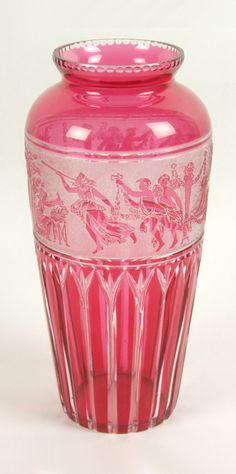 Moser style Art Deco glass vase, ruby flash with cut vertical lancet lower section, white relief band of classical procession, notched top rim, polished pontil.