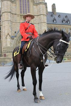 Mountie in front of Parliament Hill, Ottawa, Canada