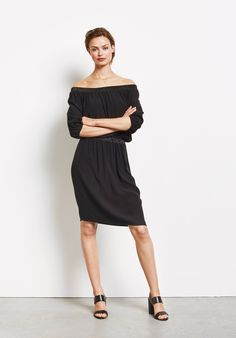 b04a2e65af8dca This oh-so elegant dress has a Bardot style neckline to accentuate the  shoulders and