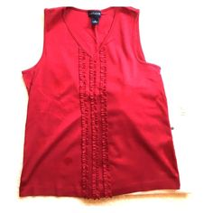 Ann Taylor red Latin inspired ruffle tee Dark red sleeveless tee with ruffle edge front Great condition. ( jeans not included, shoes sold separately. Ann Taylor Tops Tees - Short Sleeve