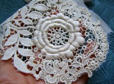 JULY 4th SALE 35% off it was $45 Now $28 ONLY for 3 DAYS    Exquisite rare circa 1880s French Belle Epoque schiffli guipure cotton lace trim with very beautiful floral and greenery design so gorgeous very raised even in the back , rare embroidery really scarce. You can use it as it is or separate in 3 smaller appliques. Was part of an scrumptious outfit and still has a piece of a silk organdy attached. In very nice antique condition may have a bit yellowish usually found in old laces but…
