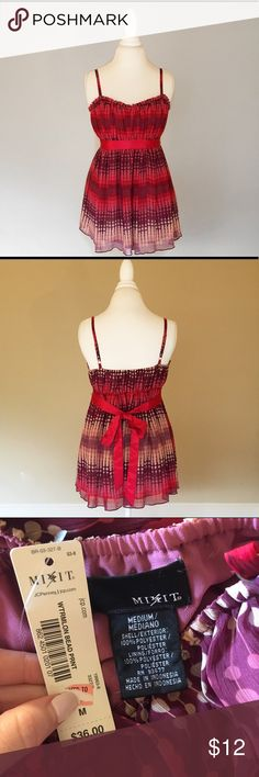 Babydoll Style Spaghetti Strap Top Adorable baby doll tank top with a sash to tie around the waist. Very feminine and girly. Brand new with tags still attached! Reasonable offers welcome. Bundle with other items in my closet to save. Tops Tank Tops