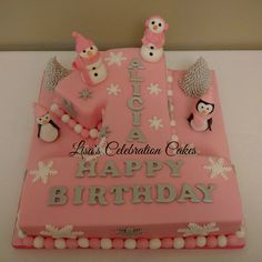 Winter wonderland number one cake with fondant snowmen and penguins
