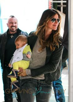 Gisele Bundchen carries her daughter Vivian Lake as she goes apartment shopping in NYC