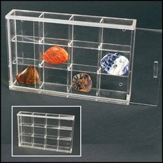 """Made of crystal clear acrylic glass, these sleek cabinets are made to hang on your wall and come in 6 different styles/sizes.  Since they are frameless and hingeless, the focus is on your collection, not the hardware.  The clear front panel slides into place.   12 compartments 1-9/16"""" x 1-3/8"""" x 7/8"""" each Overall cabinet size 7-1/16"""" x 4-1/2"""" x 13/16""""   See more sizes at http://www.safepub.com/sections/rock-mineral-display-cases"""