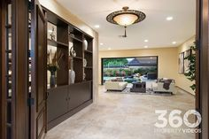 This fabulous Hawaiian home by Pyramid Premier Properties features Authentic Durango Stone travertine tiles in every room of the home. This versatile, beige natural stone fits perfectly in this luxurious living room leading to an outdoor patio.