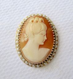 Vintage Victorian Style 14K Yellow Gold Pearl Framed Carved Shell Cameo Pendant Brooch. Rare left facing profile. A beautiful gold Cameo pendant and or brooch c