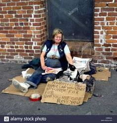 homeless women street | Homeless Woman And Cats With Sign Asking For Spare Change On Hyde ...