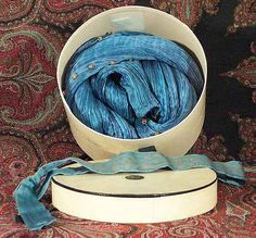 Mariano Fortuny box for Delphos dress. Because of the fabric and the dyes the dresses were rolled and sold is custom made boxes.