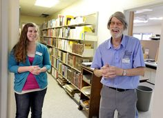 Ames Historical Society curator Dennis C. Wendell and director Casie Vance joke around inside the organization's newly renovated building at 416 Douglas Ave in Ames. Photo By Eli Hamann/Ames Tribune