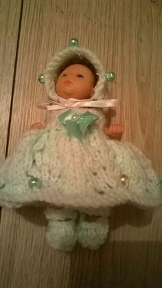 Very pretty hand knitted dolls clothes fits 4.5 inch doll, shown here on an Ashton Drake heavenly handfulls doll.
