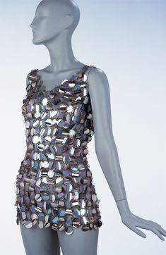 Paco Rabanne led the field of radical experimentation in elite fashion design. Using techniques borrowed from jewellery, he created sculptural dresses in unconventional materials, which inspired inferior copies in London. Baroness Helen Bachofen von Echt wore this dress to a party in New York where she danced with Frank Sinatra.