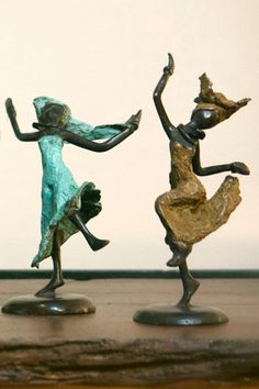 "Lost Wax Dancers from Burkina Faso  Our gorgeous fair trade statues are what we call ""lost wax"" figures, an ancient practice in which an artist creates an original sculpture out of wax. Hand made in Ouagadougou, Burkina Faso by fair trade artisans, our dancing ladies are impossible to look at without having your day brightened, their joy is infectious."