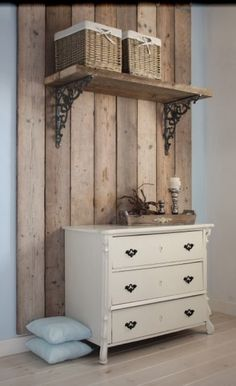 A handful of wood floor planks create a beautiful backdrop for a vintage dresser
