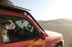 Henry Cavill and Neil Hodgson drive across Taklamakan Desert in China.