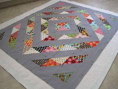 Modern gender-neutral baby quilt/play mat made with half square triangles. I want to make something like this.