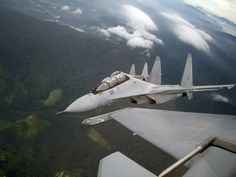 A look from the WSO's cockpit of a Royal Malaysian Air Force Sukhoi Su-30MKM (NATO reporting name: Flanker-H) flying in formation with other Su-30MKMs