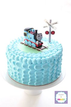 Thomas the Tank Engine Smash Cake and cake topper by Sweet & Snazzy https://www.facebook.com/sweetandsnazzy